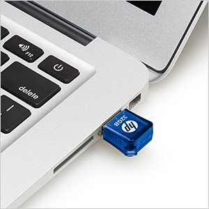 HP v165w USB flash drive plugged into laptop