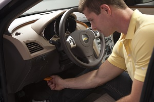 Plug the U-Scan device into your vehicle's OBD port