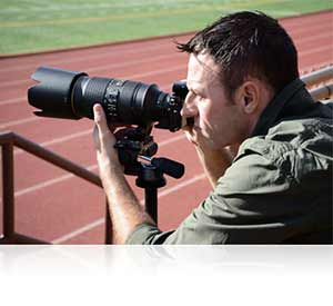 Photo of a man shooting with the Nikon 1 V3 on a track field showing high end design