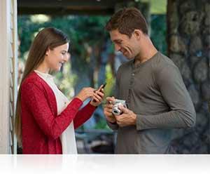 Nikon 1 J4 photo of a couple highlighting instant sharing via Wi-Fi