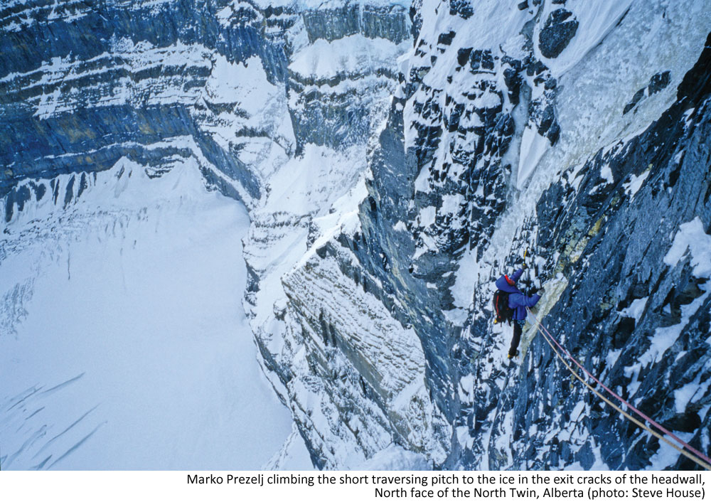 Marko Prezelj climbing the short traversing pitch to the ice in the exit cracks of the headwall. North face of the North Twin, Alberta