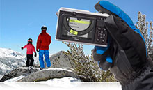 Photo of the Nikon 1 AW1 showing action control with skiiers on a mountain in the background
