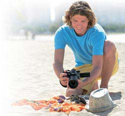 Man at beach shoots objects on towel with Vari-angle LCD