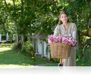 Nikon D610 foto de una mujer en un jardín que muestra el detalle
