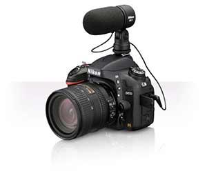 Nikon D610 foto del producto con un lente y el micrófono estéreo ME-1 adjunta.