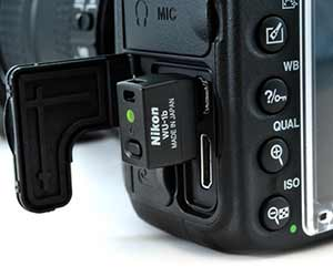Nikon D610 and the WU-1b showing Wi-Fi capabilities.