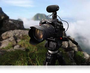 Nikon D7100 and lens and ME-1 microphone on tripod atop a mountain