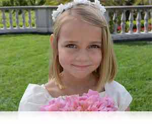 Full HD (1080p) movies with stereo sound photo of a flower girl at a wedding