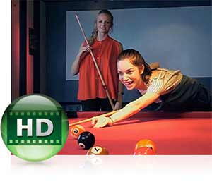 Nikon COOLPIX S5300 photo of two women playing billiards inset with the HD video icon showing video capabilities.