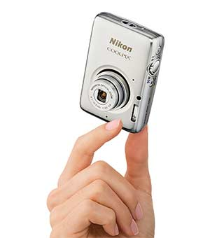 Photo of a hand holding the COOLPIX S02 camera, showing how small it is physically