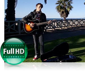 Photo of a guy with a guitar outdoors, playing, showing teh Full HD video capability of the COOLPIX S02