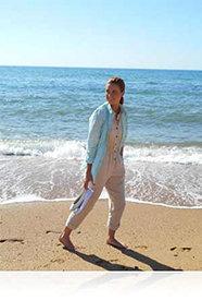 Nikon COOLPIX L30 photo of a woman walking at the ocean's edge