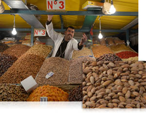 photo of a man selling nuts at a market, shot with the D600
