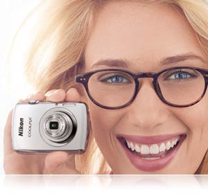 photo of blonde woman holding the small COOLPIX S01