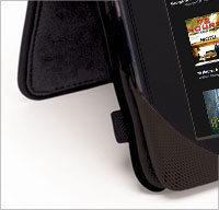 Anti-slip silicone grips stabilize Kindle in stand position