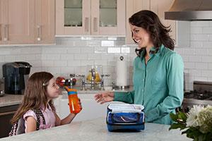 Mom and daughter in kitchen with Contigo Striker