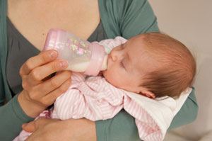 Baby feeding from anti-colic bottle