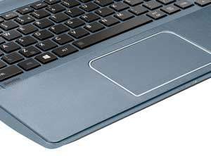The large touchpad includes gesture controls and integrated buttons.