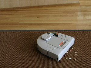 The Neato cleans all your floors - carpets, rugs, hardwood, laminates, tile and stone.