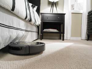 Roomba is less than 10cm 'tall', so it can clean under a lot more furniture