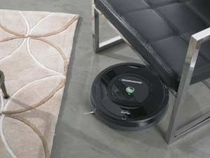 Roomba gets into hard-to-reach places including under and around furniture and even self-adjusts between floor types