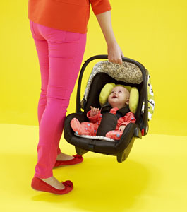 Woman carrying Giggle car seat
