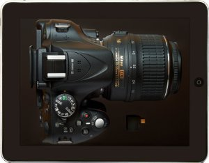 This picture shows the D5200 camera with a wireless adapter and Apple iPad.